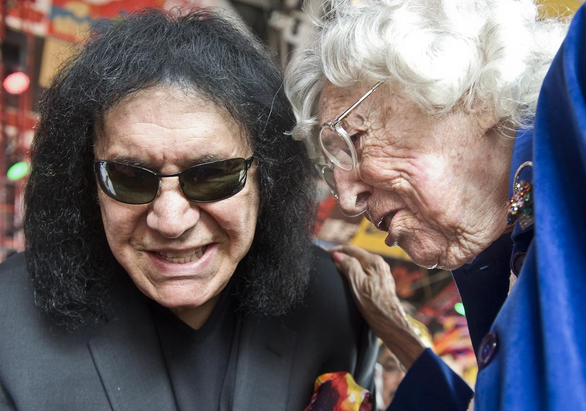 Kiss bassist Gene Simmons listens to Mary Hicks, 101, of Buena Park speak about her experiences as a staff sergeant in the U.S. Army from 1943-1945 during the grand opening of Rock & Brews in Buena Park. The restaurant treated Buena Park veterans to lunch for their grand opening celebration.